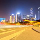 City road with modern buildings at night Royalty Free Stock Photos