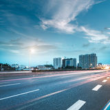 City and road. The city and the road in the modern office building background royalty free stock image