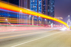 City road at night with dramatic light trails Stock Photo