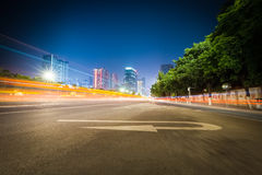 City road at night. Light trails with traffic sign stock photos