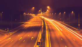 City road night scene. Long exposure light trails royalty free stock images