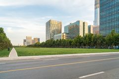 City road scene in tianjin. City road scene with green space and modern buildings at dusk in tianjin Royalty Free Stock Image