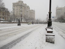 City road. Snowing in the city road stock photo