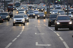 City road with vehicles. Evening city road with vehicles stock photography