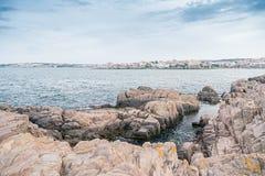 City rock sea sky Stock Photography
