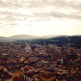 City roofs from Campanile of Florence Cathedral. Roofs of Florence from belfry. Aged photo. View of Firenze city with Basilica of Santa Croce in the distance Stock Photography