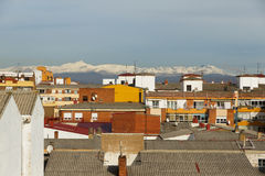 City roofs with snowy mountains in the background Stock Photography