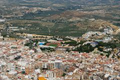 City rooftops and olive groves, Jaen, Spain. Royalty Free Stock Photography