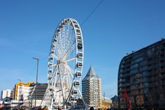 The city of rotterdam, its modern buildings, the metropolis and the big ferris wheel royalty free stock photography