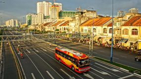 City with rows of houses and boulevard. City with row of houses in morning, vehicles moving on Dong Tay Boulevard in Ho Chi Minh, Viet Nam on November  22, 2013 Stock Images