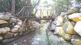 City ruins Olimpos bridge through a stream stock video