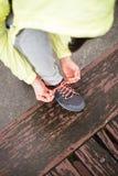 City runner lacing sport footwear before training Stock Image