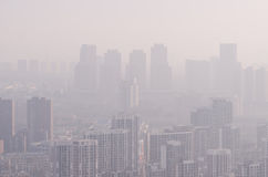 The city's blocks and buildings shrouded in a pollution haze. Royalty Free Stock Images
