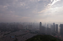 The city's blocks and buildings shrouded in a pollution haze. Royalty Free Stock Photo