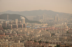 The city's blocks and buildings shrouded in a pollution haze. Stock Photo