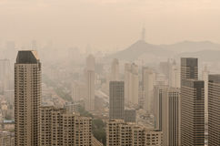The city's blocks and buildings shrouded in a pollution haze. Stock Photography