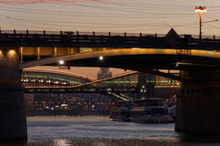 The city's river at sunset. Bridges are illuminated by colored lights. Moscow, Russia Stock Images