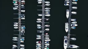 City`s sea port with luxury white speedboats in the rows in harborside stock video footage