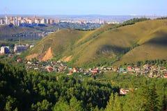 The city`s skyline. House, mountain, trees. A scenic view. The City Of Krasnoyarsk Stock Image