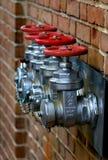City's still life. Fire hidrants on the red brick wall,  City's still life Royalty Free Stock Photography