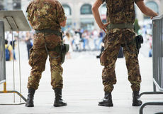 City safety. military police in the street. City safety and security. armed military police watching order in the urban street royalty free stock images