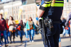 City safety. policeman in the street. City safety and security. policeman watching order in the urban street stock photography