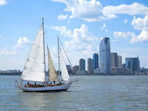City and a Sail Boat Stock Photos