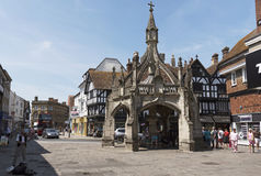City of Salisbury Wiltshire England UK. Tourists on tour looking at the famous Haunch of Venison pub opposite the Poultry Cross in the city center of Salisbury royalty free stock images
