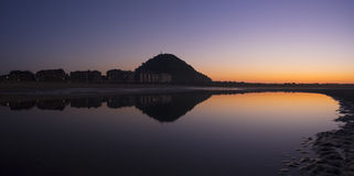 City of San Sebastian reflected in the water of the beach Stock Image
