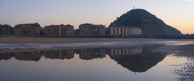 City of San Sebastian reflected in the water of the beach Stock Photography
