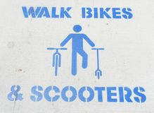 Walk Bikes & Scooters royalty free stock photography