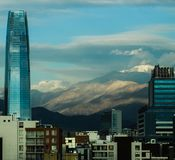 A view of Santiago and the Andean Mountains. The city of Santiago, Chile, and its most famous building and natural landscape: the Andes or Andean Mountains stock photos