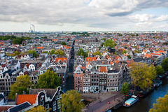 City scape of Amsterdam. View of Amsterdam from  a church tower with tipical houses and canal in forefront Royalty Free Stock Images