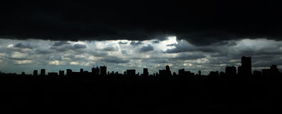 City scape of building. Silhouette and dark cloud Royalty Free Stock Images