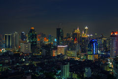 City scape in heart of bangkok thailand with beautiful lighting. Of office building and sky scrapper against dusky sky twilight time Stock Photos