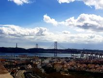 Lisbon city scape with bridge and Christ statue Stock Photos