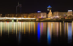 City scape Lyon by night. Cityscape: illuminated bridge over the Rhone river in Lyon at dusk. Long exposure and night photography with two tower in the Stock Images