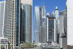 City scape with modern high-rise buildings and blue sky in background at Dubai.  Royalty Free Stock Image