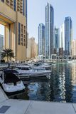City scape with modern high-rise buildings, man made river with yachts and blue sky in background at Dubai.  Royalty Free Stock Photography