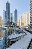 City scape with modern high-rise buildings, man made river with yachts and blue sky in background at Dubai.  Royalty Free Stock Photo