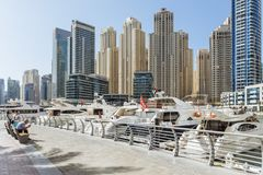 City scape with modern high-rise buildings, man made river with yachts and blue sky in background at Dubai.  Stock Photo