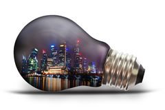 City scape at night light bulb. Light bulb with city scape at night Royalty Free Stock Photos