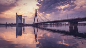 City scape with Vansu bridge in sunset. City scape with bridge in sunset. Vanšu bridge in Latvija, Riga. Latvia over river Daugava. Sky full of clouds. Photo Stock Photography