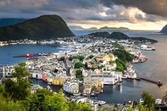 City Scene with Aerial View of Alesund Center at Dramatic Sunset stock photography