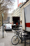 City scene and delivery truck Stock Photos