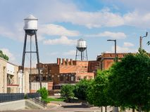Water Tower in Pueblo, Colorado. A city scene near the Riverwalk in Pueblo, Colorado showing water towers and a blue sky stock photography