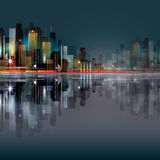 City scene at night with waterfront Royalty Free Stock Images