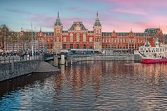 City scenic from Amsterdam with the central station in Netherands. City scenic from Amsterdam with the central station in the Netherlands at sunset Stock Photos