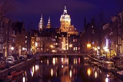 City scenic in Amsterdam the Netherlands. With the st niklaas kerk at night Royalty Free Stock Images