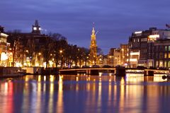 City scenic from Amsterdam Netherlands. City scenic with theMunt tower at night in Amsterdam the Netherlands Royalty Free Stock Photography